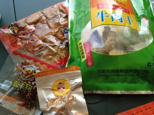 The green package is Chinese spiced beef jerky.   We also have spicy tofu on the upper left. The smaller packages are dried beef with various spices. All are delicious.